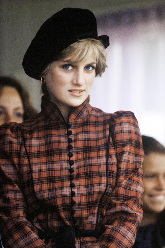 <p>Princess Diana got into the Scottish spirit with her plaid ensemble while attending the Braemar Highland Games in September 1982.</p>