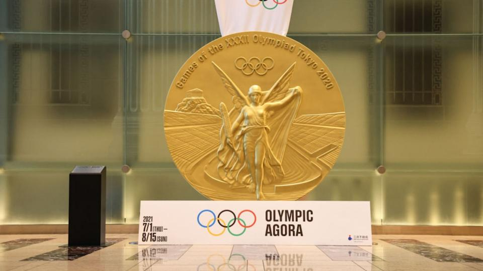 Large replica of the gold medal Tokyo Olympic winners will receive at the current games.