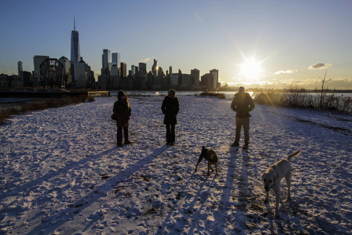 <p>People walk their pets as the skyline of New York City and One world Trade Center are seen during freeze temperatures on Jan. 6, 2018 in Exchange Place, N.J. (Photo: Eduardo Munoz Alvarez/Getty Images) </p>