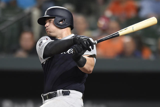 New York Yankees' Luke Voit singles against the Baltimore Orioles during the seventh inning of a baseball game, Sunday, Aug. 26, 2018, in Baltimore. The Yankees won 5-3. (AP Photo/Gail Burton)
