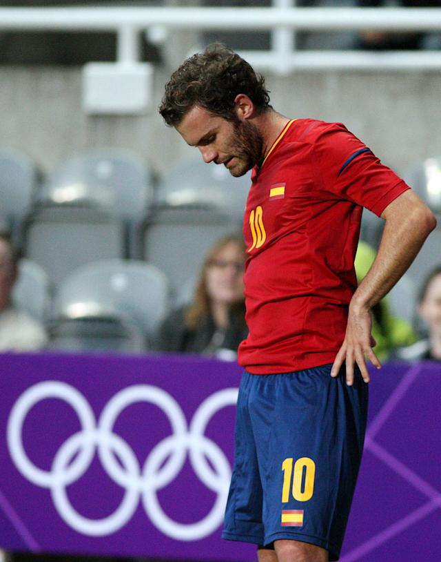 Spain's Juan Mata looks down at the field after being defeated by Honduras at the end of the group D men's soccer match at St. James' Park, in Newcastle, England, during the London 2012 Summer Olympics, Sunday, July 29, 2012. (AP Photo/Scott Heppell)