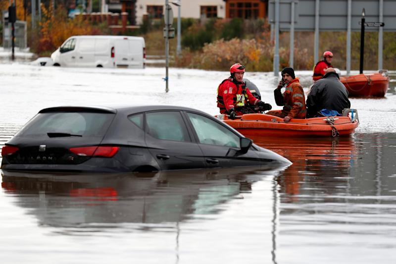 Rescue operations tried to get waterlocked residents to areas of safety (Getty Images)