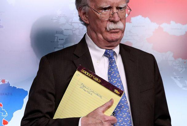 PHOTO: National Security Advisor John Bolton listens to questions from reporters during a press briefing at the White House, Jan. 28, 2019, while holding a legal pad with handwritten notes. (Win McNamee/Getty Images, FILE)