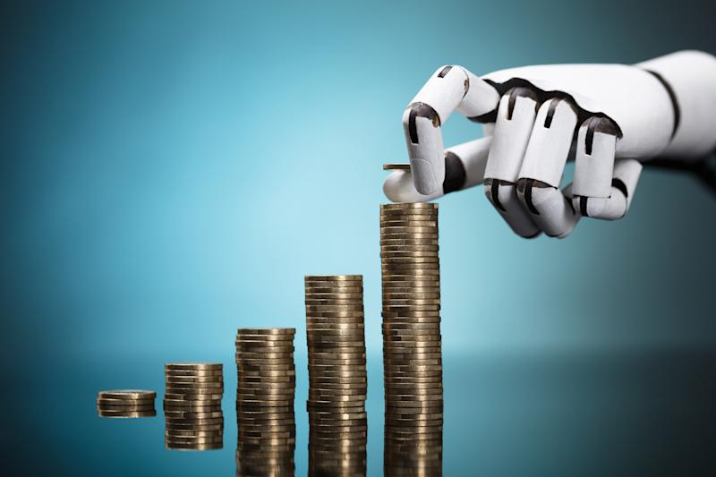 Robot Stacking Coins On Turquoise Background