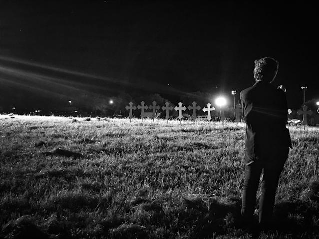 <p>A woman stands near 26 crosses set up in honor of those killed in Sunday's mass shooting in Sutherland Springs, Texas. (Photo: Holly Bailey/Yahoo News) </p>