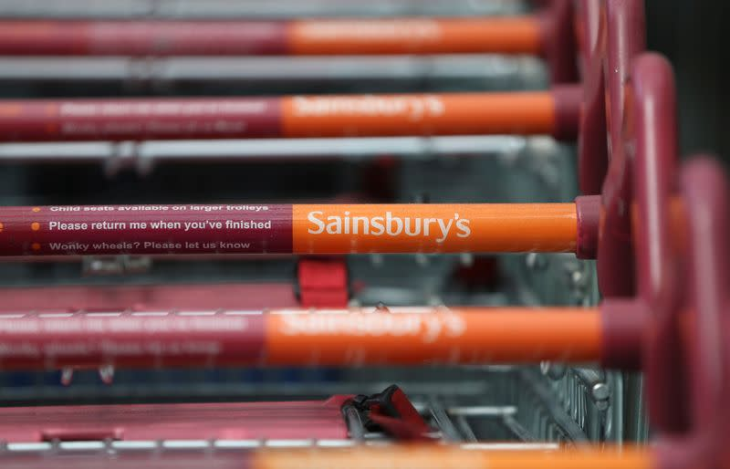 FILE PHOTO: Shopping trolleys at a Sainsbury's store in London