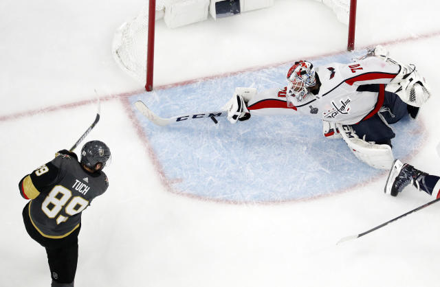 Washington Capitals goaltender Braden Holtby, right, makes a stick save on shot by Vegas Golden Knights right wing Alex Tuch during the third period in Game 2 of the NHL hockey Stanley Cup Finals on Wednesday, May 30, 2018, in Las Vegas. (AP Photo/John Locher)
