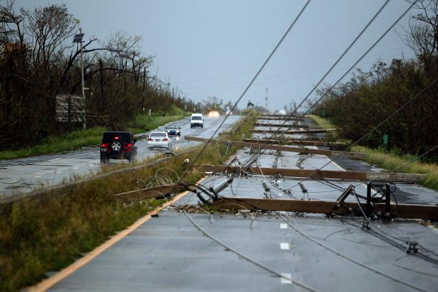 <p>Concrete power line poles lies on a highway after the area was hit by Hurricane Maria in Luquillo, Puerto Rico on Sept. 20, 2017. (Photo: Ricardo Arduengo/AFP/Getty Images) </p>