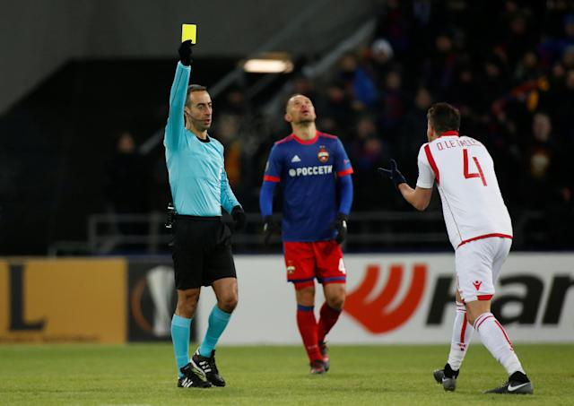 Soccer Football - Europa League Round of 32 Second Leg - CSKA Moscow vs Red Star Belgrade - VEB Arena, Moscow, Russia - February 21, 2018 The referee shows Red Star Belgrade's Damien Le Tallec a yellow card REUTERS/Maxim Shemetov