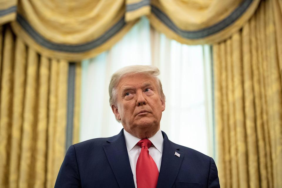 <p>Donald Trump, pictured on Friday, is being sued by 20 plaintiffs over an alleged fraud scheme involving thousands of tenants in apartment buildings built by his father</p> (AFP via Getty Images)