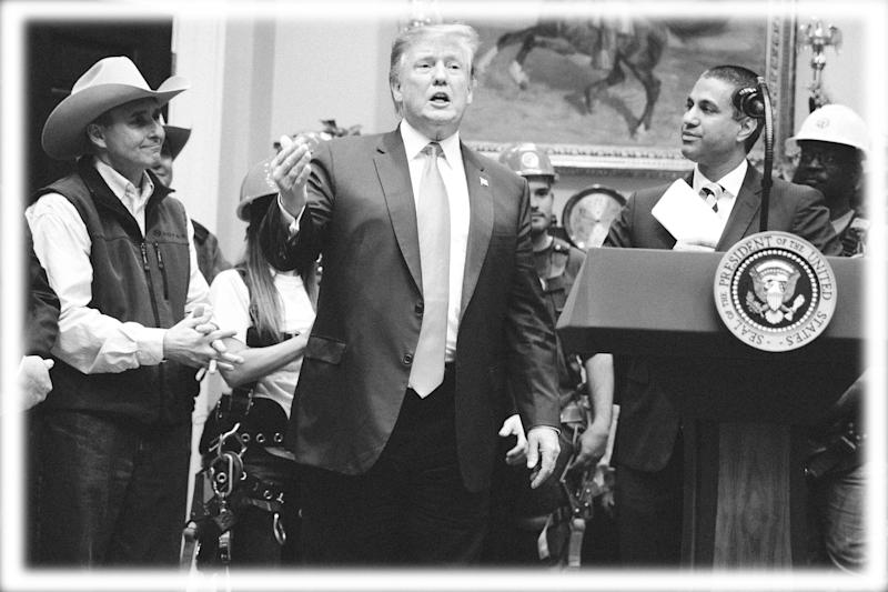 FCC chairman Ajit Pai, right, looks on as President Donald Trump delivers remarks on the deployment of 5G technology in the United States during an event in the Roosevelt Room of the White House, Friday, April 12, 2019, in Washington. (Photo: Evan Vucci/AP, digitally enhanced by Yahoo News)