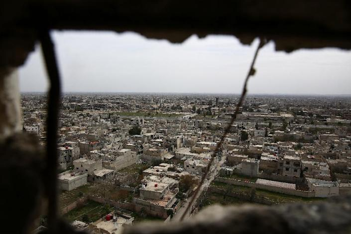 A general view taken from the al-Qaboun rebel held northeastern suburb of the capital Damascus on March 13, 2016 shows damaged buildings in the nearby Jobar neighbourhood (AFP Photo/Abd Doumany)