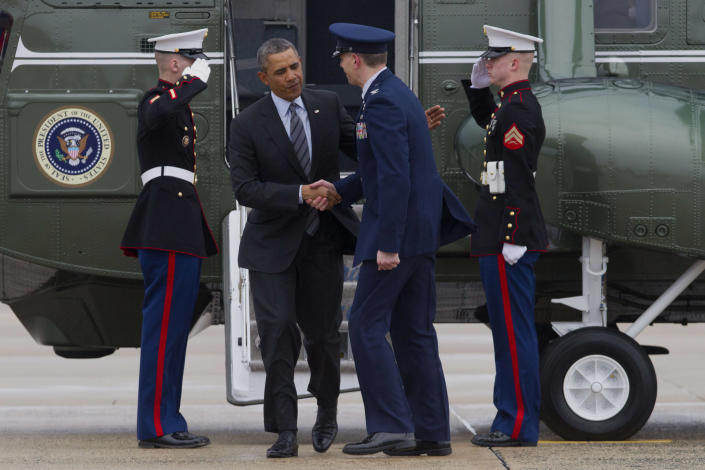 """President Barack Obama is greeted by Air Force Col. Daniel Waters, vice-commander of Andrews Air Force Base, upon his arrival at Andrews Air Force Base, Md., Wednesday, Feb. 19, 2014, before traveling to Toluca, Mexico to participate in the seventh trilateral North American Leaders Summit Meeting, where he will meet with Canadian Prime Minister Stephen Harper and Mexican President Enrique Peña Nieto. This year's theme is """"North American Competitiveness.""""(AP Photo/Jacquelyn Martin)"""