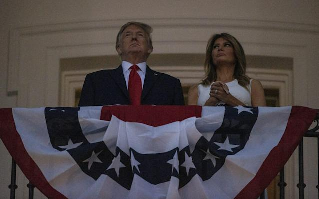 Donald Trump and first Lady Melania Trump watch fireworks at the White House on July 4 - Getty