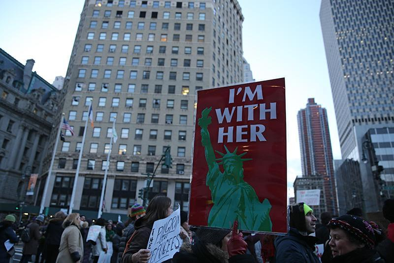 <p>People hold up signs in New York's Foley Square in New York, Jan. 29, 2017, protesting President Donald Trump's immigration order. (Gordon Donovan/Yahoo News) </p>
