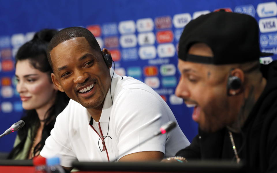 Nicky Jam, Will Smith, and Era Istrefi at the World Cup on July 13. (Photo: EFE)