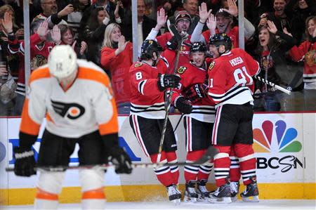 Chicago Blackhawks right wing Kris Versteeg (23) is congratulated by his teammates for scoring a goal against the Philadelphia Flyers during the second period at the United Center. Rob Grabowski-USA TODAY Sports