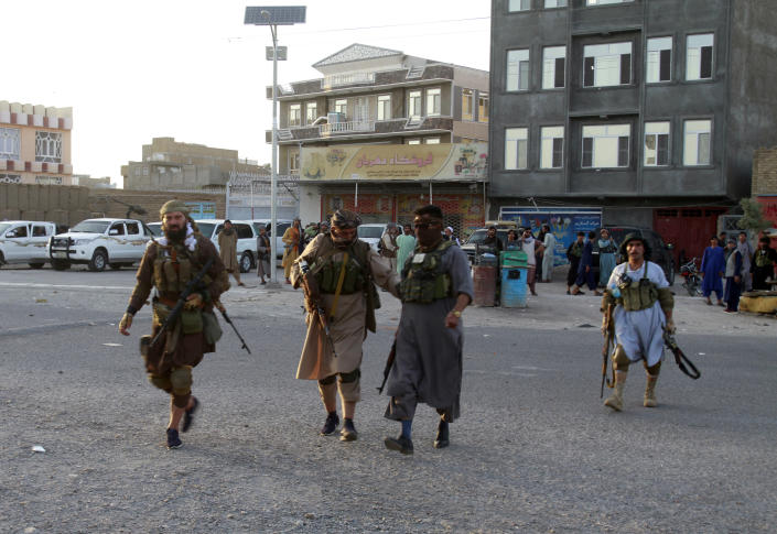 Private militia loyal to Ismail Khan, the former Mujahideen commander, patrols after security forces took back control of parts of Herat city following fighting between Taliban and Afghan security forces in Herat province, west of Kabul, Afghanistan, Friday, Aug. 6, 2021. (AP Photo/Hamed Sarfarazi)