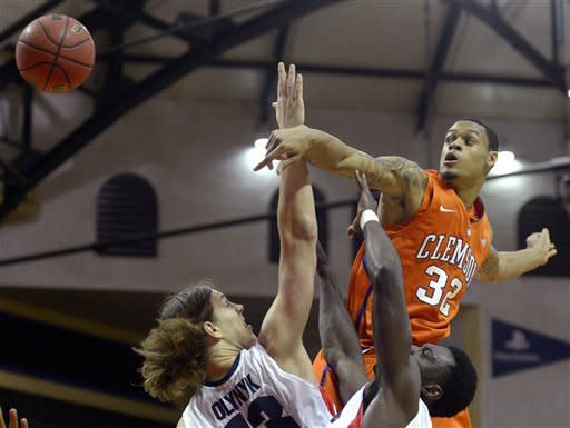 Clemson's K.J. McDaniels (32) swats the ball away from Gonzaga's Kelly Olynyk, left, and Guy Landry Edi while fighting for a rebound during the first half of an NCAA college basketball game at the Old Spice Classic in Kissimmee, Fla., Thursday, Nov. 22, 2012. (AP Photo/Phelan M. Ebenhack)