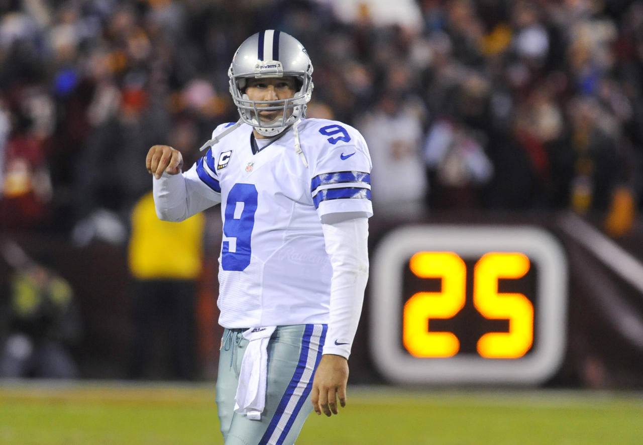 Dallas Cowboys quarterback Tony Romo reacts after throwing his second interception during the first half of an NFL football game against the Washington Redskins, Sunday, Dec. 30, 2012, in Landover, Md. (AP Photo/Richard Lipski)