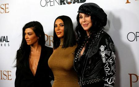"""Singer Cher poses with television personalities Kim Kardashian and Kourtney Kardashian at the premiere of """"The Promise"""" in Los Angeles, California"""