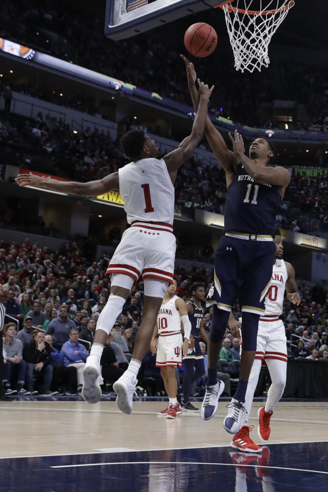Notre Dame's Juwan Durham (11) is fouled by Indiana's Al Durham (1) tase he goes up for a shot during the first half of an NCAA college basketball game, Saturday, Dec. 21, 2019. (AP Photo/Darron Cummings)