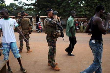 French peacekeeping soldiers patrol a street of the mostly muslim neighbourhood of PK 5 in Bangui, Central African Republic,