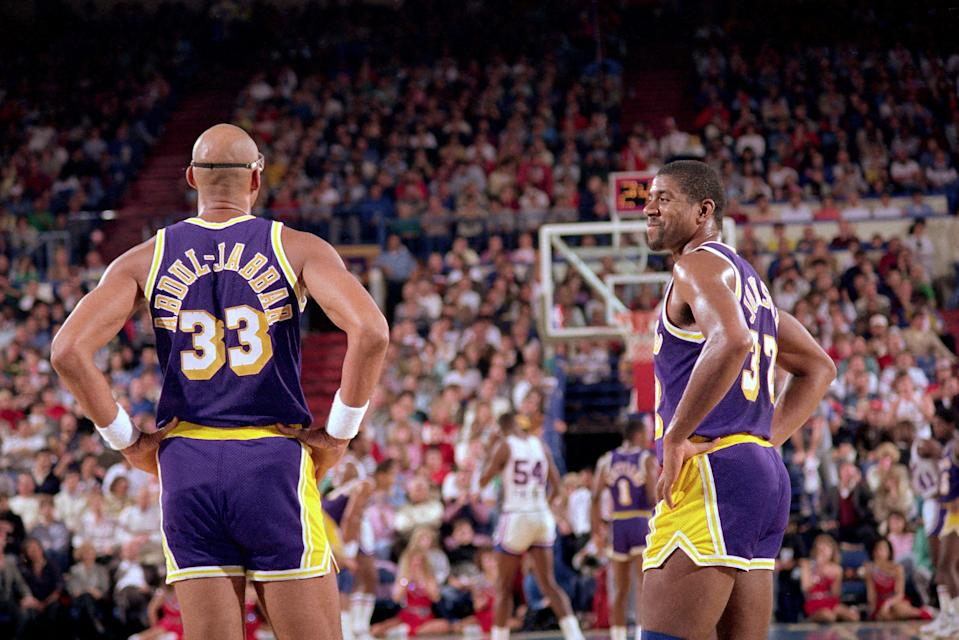 SACRAMENTO, CA - DECEMBER 1: Kareem Abdul-Jabbar #33 and Magic Johnson #32 of the Los Angeles Lakers look on against the Sacramento Kings on December 1, 1987 at Arco Arena in Sacramento, California. NOTE TO USER: User expressly acknowledges and agrees that, by downloading and or using this photograph, User is consenting to the terms and conditions of the Getty Images License Agreement. Mandatory Copyright Notice: Copyright 1987 NBAE (Photo by Rocky Widner/NBAE via Getty Images)