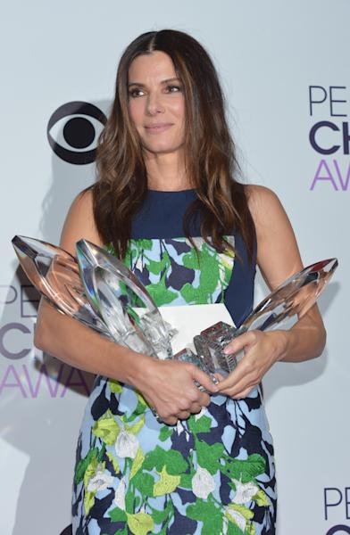 Sandra Bullock, winner of the Favorite Movie Actress, Favorite Dramatic Movie Actress and Favorite Comedic Movie Actress poses in the press room at the 40th annual People's Choice Awards at Nokia Theatre L.A. Live on Wednesday, Jan. 8, 2014, in Los Angeles. (Photo by John Shearer/Invision/AP)