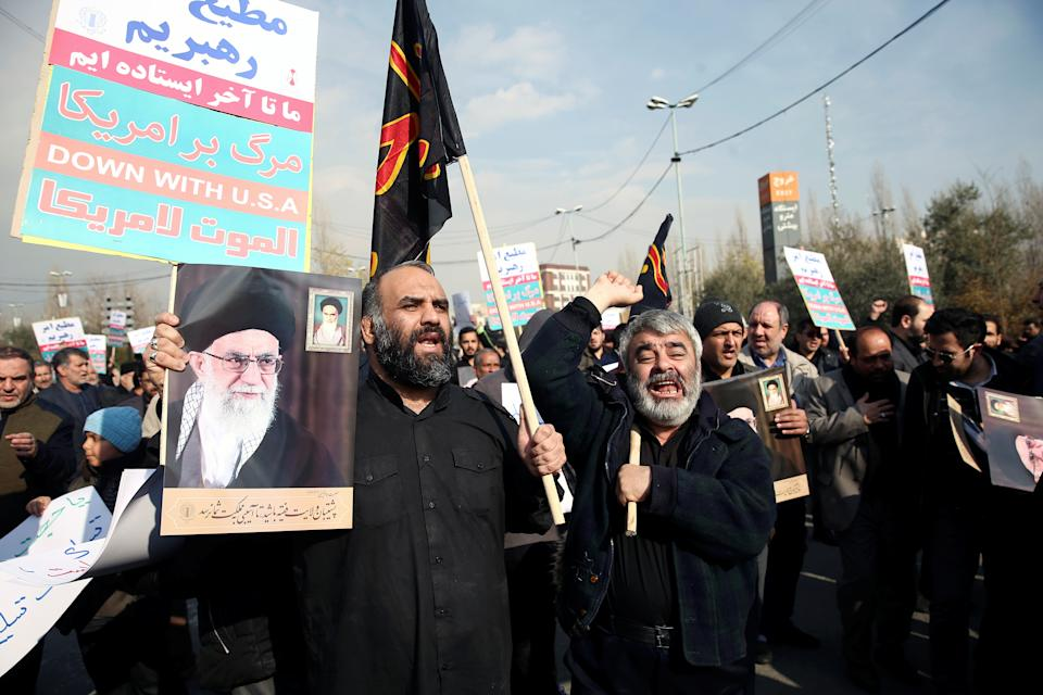 Demonstrators react during a protest against the assassination of the Iranian Major-General Qassem Soleimani, head of the elite Quds Force, and Iraqi militia commander Abu Mahdi al-Muhandis who were killed in an air strike in Baghdad airport, in Tehran, Iran January 3, 2020. WANA (West Asia News Agency)/Nazanin Tabatabaee via REUTERS ATTENTION EDITORS - THIS IMAGE HAS BEEN SUPPLIED BY A THIRD PARTY.