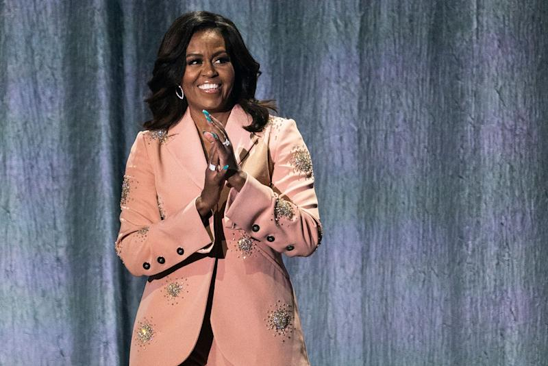 Former US first lady Michelle Obama gestures on stage of the Royal Arena in Copenhagen on April 9, 2019 during a tour to promote her memoir
