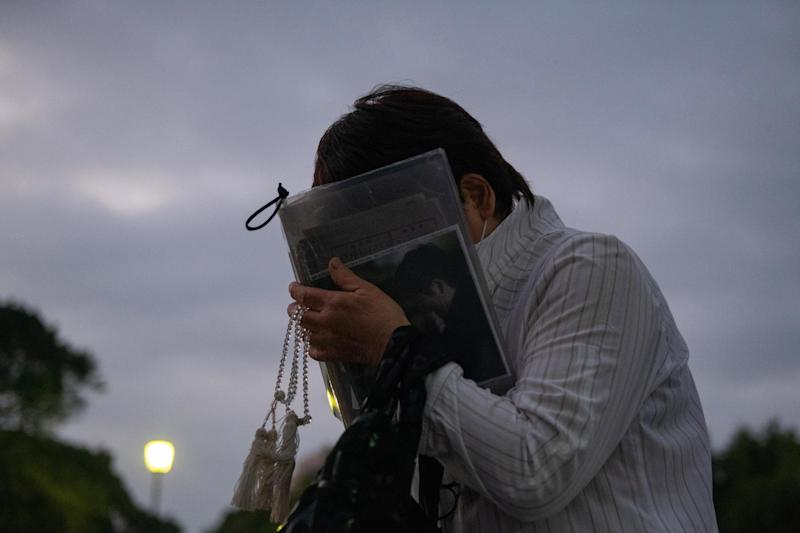 A woman prays in remembrance on the 75th anniversary of the Hiroshima atomic bombing, August 6, 2020 (Getty Images)