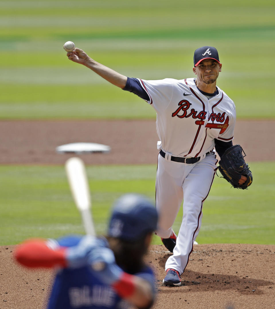 Atlanta Braves pitcher Charlie Morton pitches to Toronto Blue Jays' Bo Bichette in the first inning of a baseball game Thursday, May 13, 2021, in Atlanta. (AP Photo/Ben Margot)