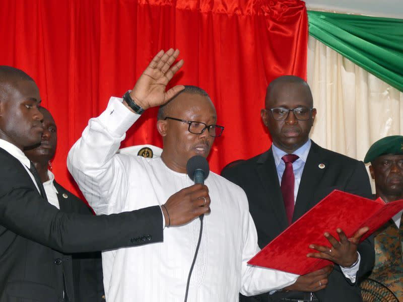 Guinea-Bissau's newly elected president Umaro Cissoko Embalo raises his arm during his swearing-in ceremony in Bissau