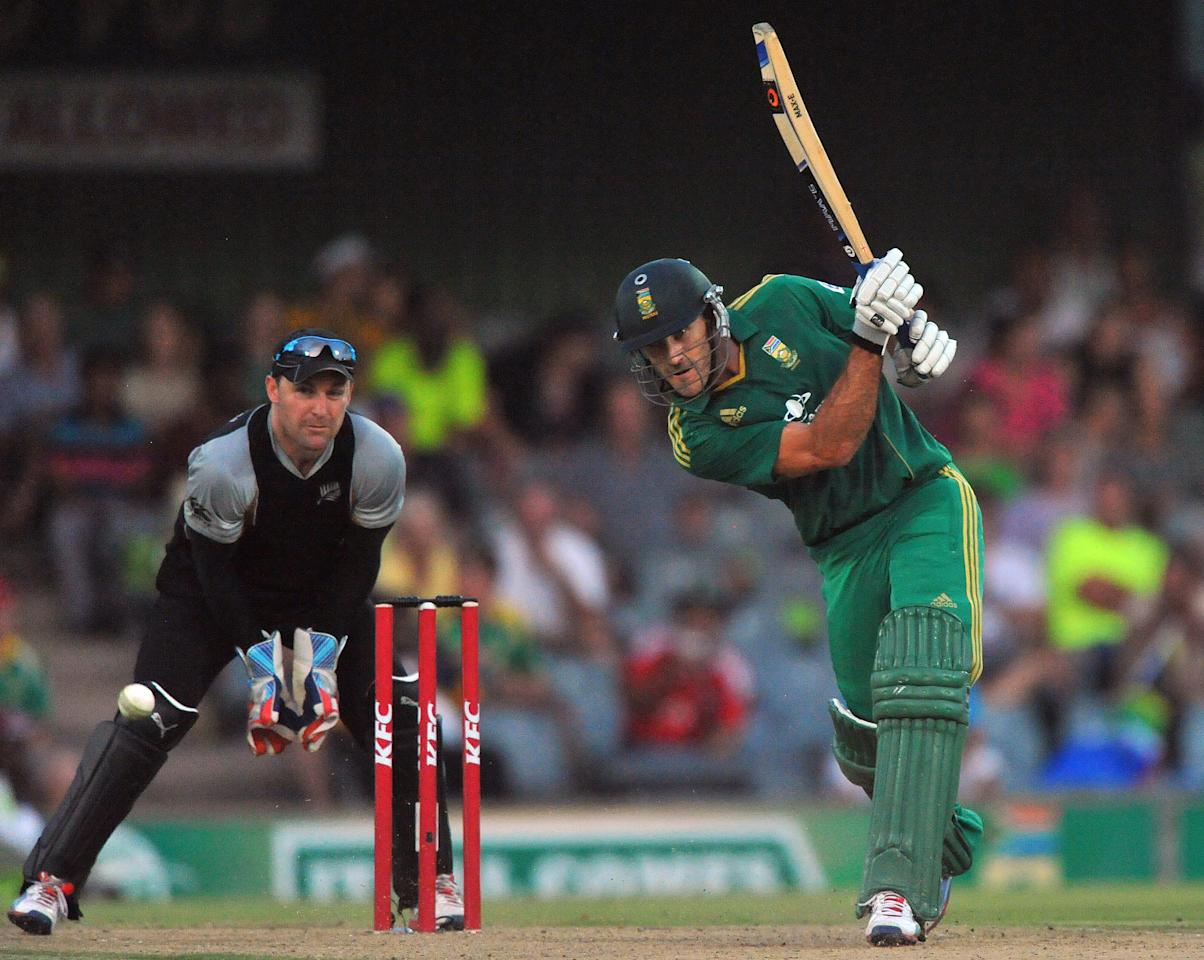 EAST LONDON, SOUTH AFRICA - DECEMBER 23:   Faf du Plessis of South Africa drives to mid-off during the 2nd T20 match between South Africa and New Zealand at Buffalo Park on December 23, 2012 in East London, South Africa.  (Photo by Duif du Toit/Gallo Images/Getty Images)