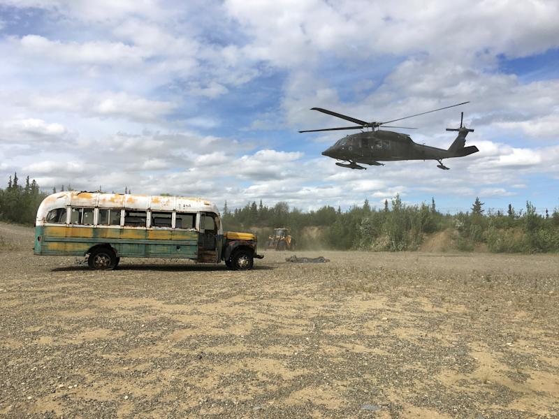 "An Alaska Army National Guard UH 60 Blackhawk helicopter hovers near ""Bus 142"", made famous by the ""Into the Wild"" book and movie, after it was deposted by a CH-47 Chinook helicopter on the ground east of the Teklanika River alongside the Stampede Road, west of Healy, Alaska, U.S. June 18, 2020. Alaska Department of Natural Resources/Handout via REUTERS. THIS IMAGE HAS BEEN SUPPLIED BY A THIRD PARTY. TPX IMAGES OF THE DAY"