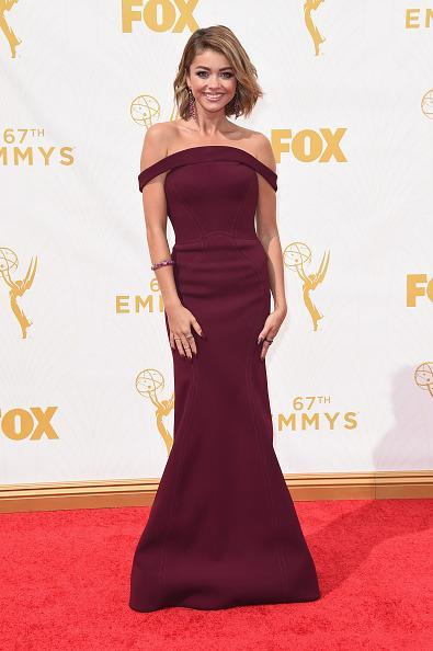 <p>Party in the front and a true fiesta in the back! Sarah Hyland's berry Zac Posen gown was incredibly on-trend with the off-the-shoulder silhouette and then she turned around to reveal a cutout.<br></p>