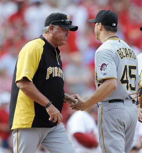 Pittsburgh Pirates starting pitcher Erik Bedard (45) is taken out of the baseball game by manager Clint Hurdle, left, during the fifth inning against the St. Louis Cardinals on Saturday, Aug. 18, 2012, in St. Louis. (AP Photo/Bill Boyce)