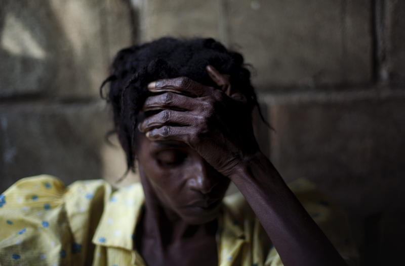 """FILE - In this Nov. 22, 2010 file photo a woman with cholera symptoms waits for treatment at a public hospital in Limbe village near Cap Haitian, Haiti.  South Korea's Yonhap News Agency announced Tuesday, July 19, 2011 that Associated Press' photojournalist Emilio Morenatti, won the top prize of its press photo contest that aims to promote the United Nations' Millennium Development Goals. Morenatti won with his entry """"Cholera Victims"""", which depicts the plight of cholera victims in Haiti in 2010. This photo is part of the winner entry.  (AP Photo/Emilio Morenatti, file)"""