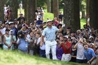 Bryson DeChambeau and spectators watch his shot from the rough on the eighth hole during the third round of the BMW Championship golf tournament, Saturday, Aug. 28, 2021, at Caves Valley Golf Club in Owings Mills, Md. (AP Photo/Terrance Williams)