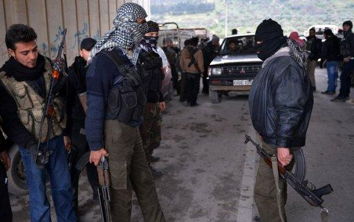 Rebels gather under a bridge during shelling by regime forces in Jisr al-Shughur. Jisr al-Shughur and Idlib city, the provincial capital, are the two key urban areas in the Sunni-dominated region on the border with Turkey that remain under the control of the Damascus central government