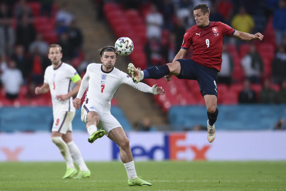 Czech Republic's Tomas Holes, right, and England's Jack Grealish go for the ball during the Euro 2020 soccer championship group D match between Czech Republic and England, at Wembley stadium in London, Tuesday, June 22, 2021. (AP Photo/Laurence Griffiths, Pool)