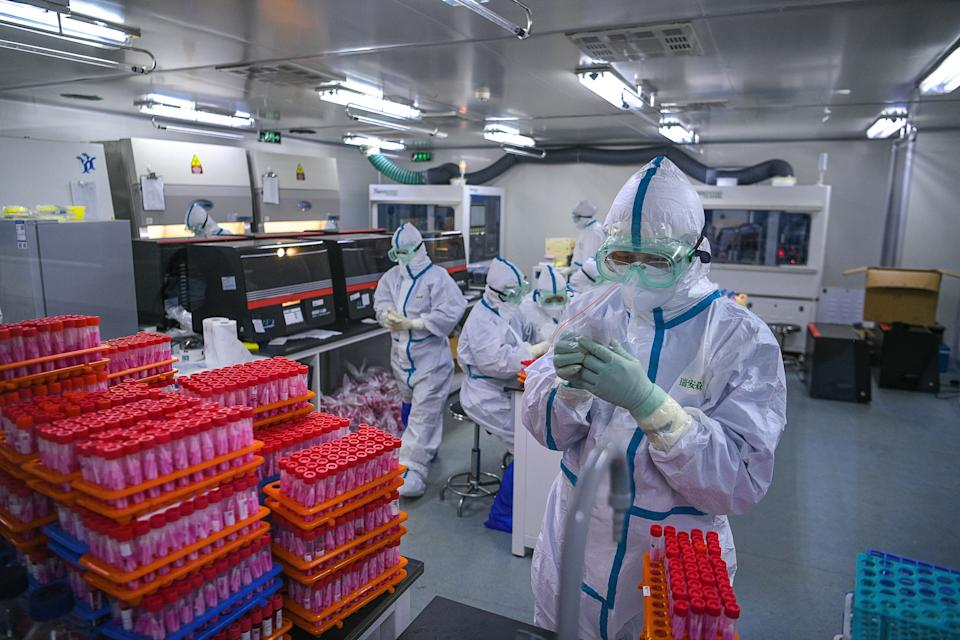 Technicians processing Covid-19 coronavirus tests at a laboratory in Tianjin, China. Source: Getty