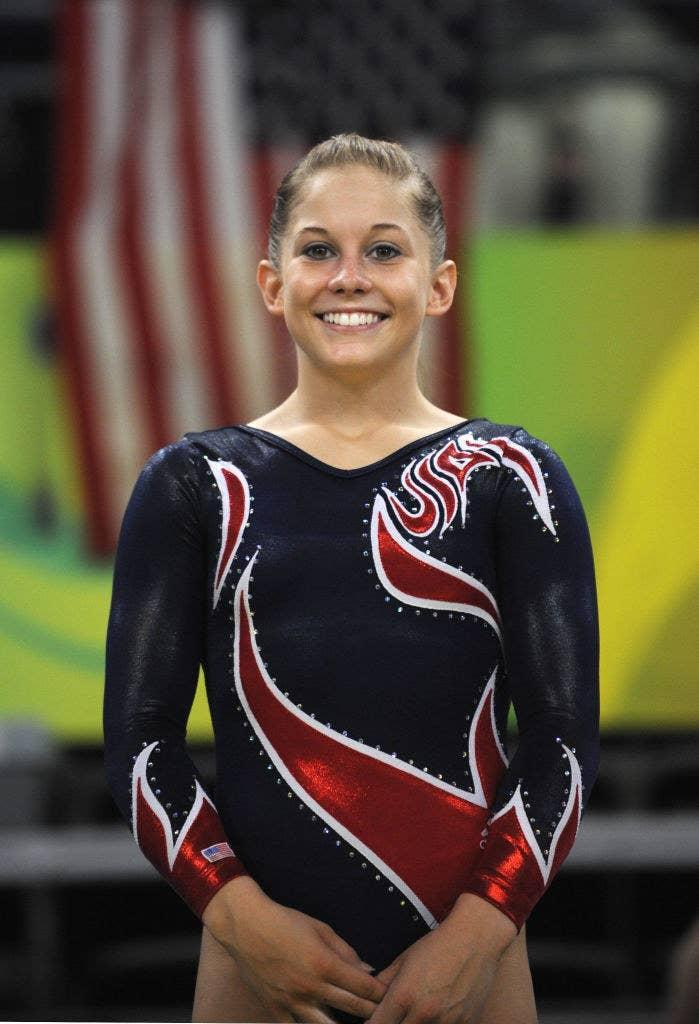 Shawn smiling as she stands in her leotard