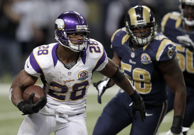 CORRECTS TO A 52-YARD GAIN, NOT TOUCHDOWN - Minnesota Vikings running back Adrian Peterson, left, runs past St. Louis Rams outside linebacker Jo-Lonn Dunbar on his way to a 52-yard gain during the fourth quarter of an NFL football game Sunday, Dec. 16, 2012, in St. Louis. (AP Photo/Tom Gannam)