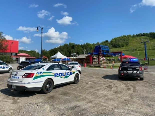 The Mont Cascades waterpark was evacuated Wednesday after a man was seen pointing what appeared to be a long gun at an employee, police said.  (Johnathan Dupaul/Radio-Canada - image credit)