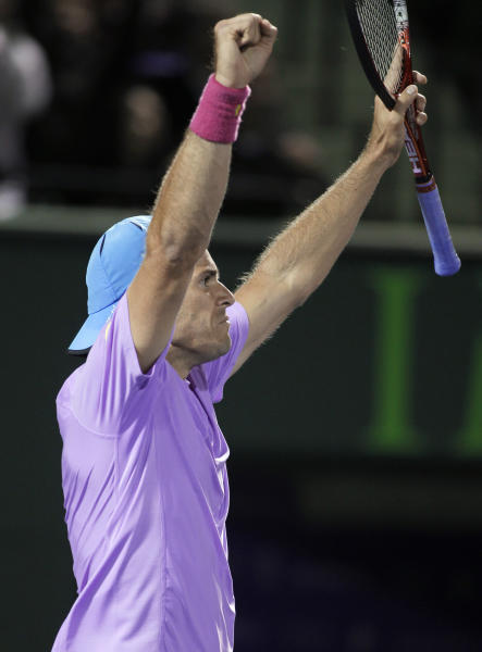 Tommy Haas, of Germany, celebrates after he defeated Novak Djokovic, of Serbia, 6-2, 6-4 at the Sony Ericsson Open tennis tournament in Key Biscayne, Fla., Tuesday, March 26, 2013. (AP Photo/Luis M. Alvarez)