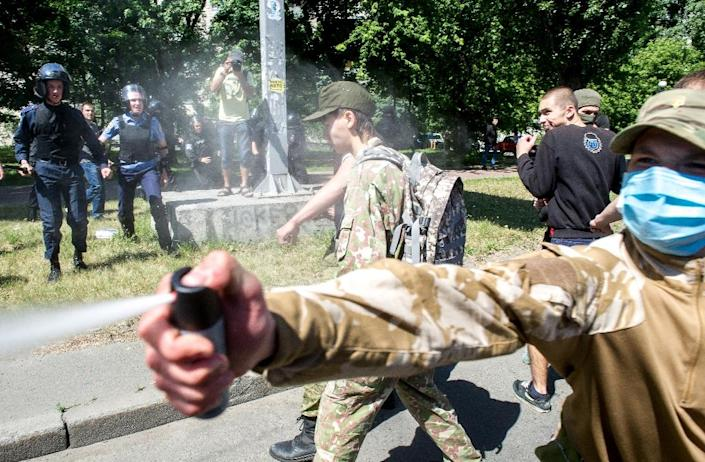 At the gay pride march in Kiev on June 6, 2015, scufles broke out after activists were attacked by far-right nationalists with tear gas (AFP Photo/Volodymyr Shuvayev)