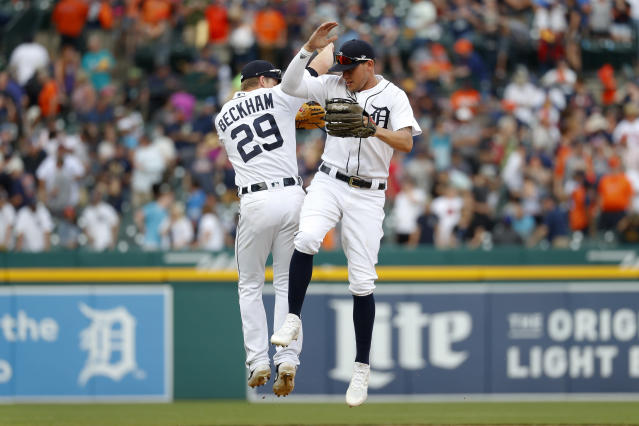 Detroit Tigers' JaCoby Jones, and Gordon Beckham (29) celebrate after the final out in the ninth inning of a baseball game against the Minnesota Twins in Detroit, Saturday, June 8, 2019. Detroit won 9-3. (AP Photo/Paul Sancya)
