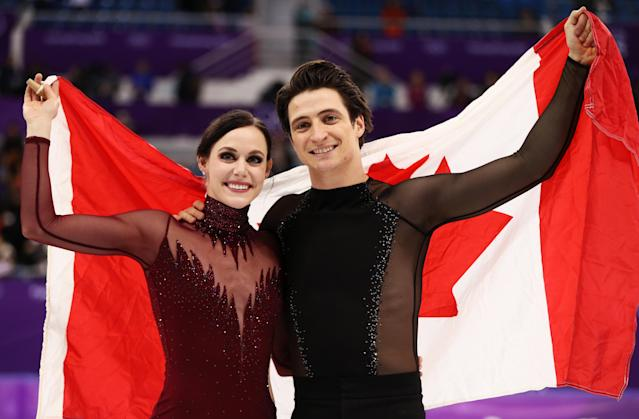 Gold medal winners Tessa Virtue and Scott Moir of Canada celebrate during the victory ceremony for the Figure Skating Ice Dance Free Dance on day eleven of the PyeongChang 2018 Winter Olympic Games. (Getty Images)